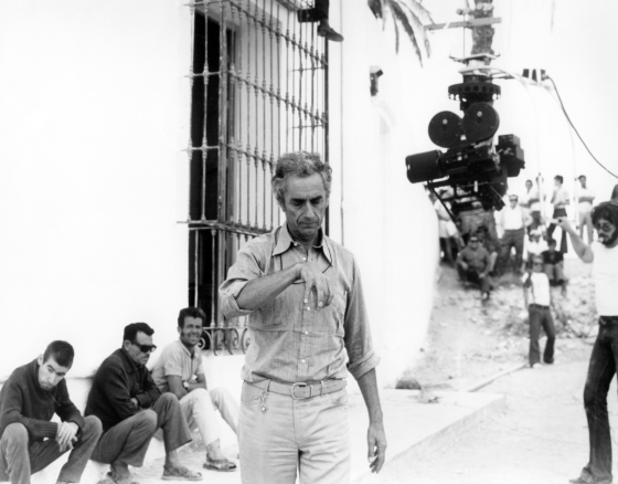 Michelangelo Antonioni on the set of The Passenger, 1975