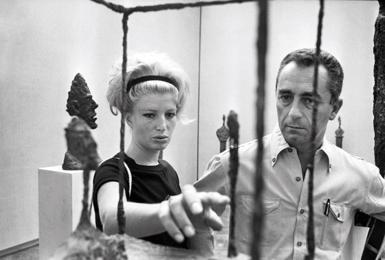 Monica Vitti and Michelangelo Antonioni in front of an Alberto Giacometti's artwork at the the Venice Biennale, 1962.
