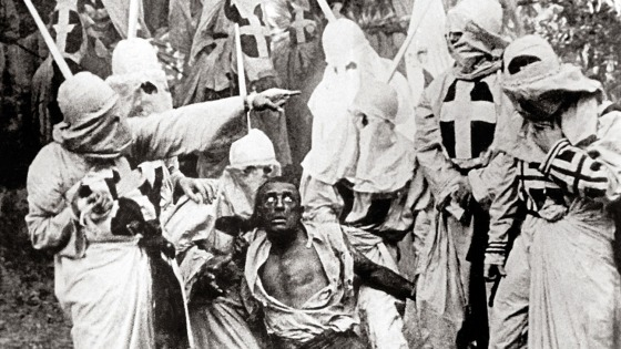 The Birth of a Nation (1915) Directed by D.W. Griffith Shown: Walter Long (as Gus) surrounded by Ku Klux Klan members