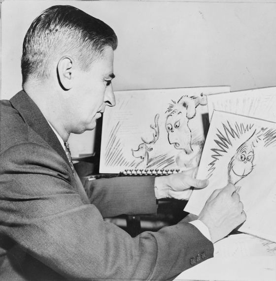 Ted Geisel at work on a drawing of the Grinch for How the Grinch Stole Christmas! in 1957